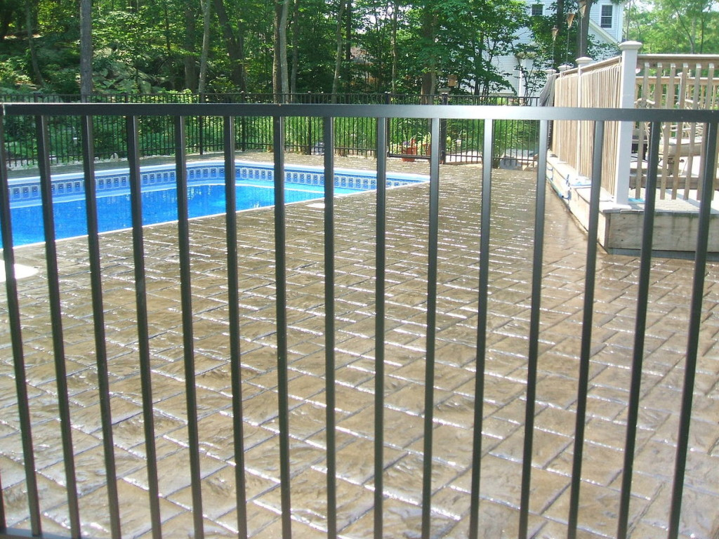Photo of Exposed Aggregate Concrete Pool Patio Cleaning and Sealing