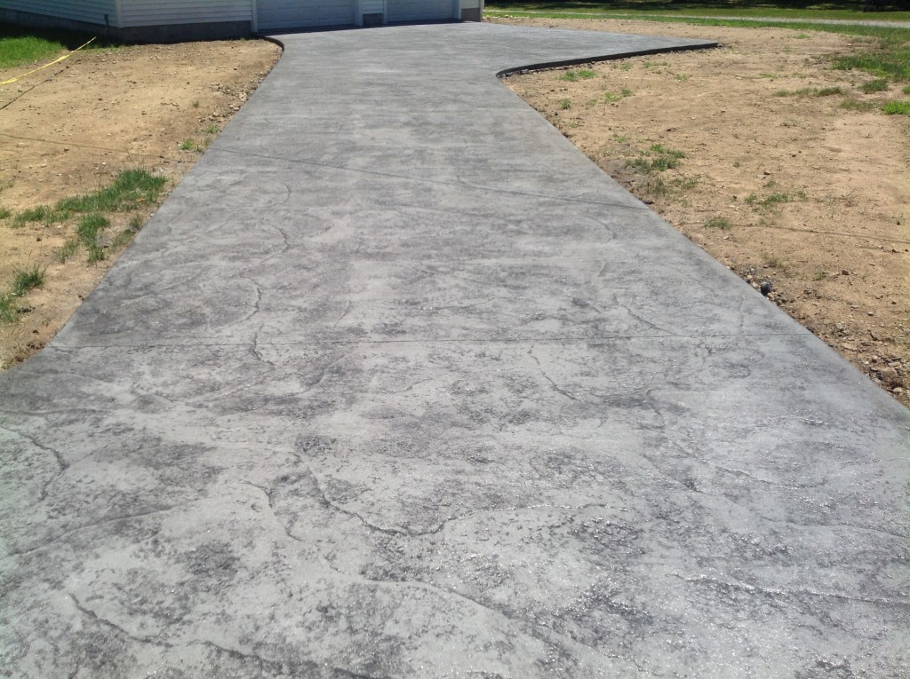 photo of a sealed stamped concrete driveway