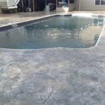 Photo of stamped concrete pool deck sealing
